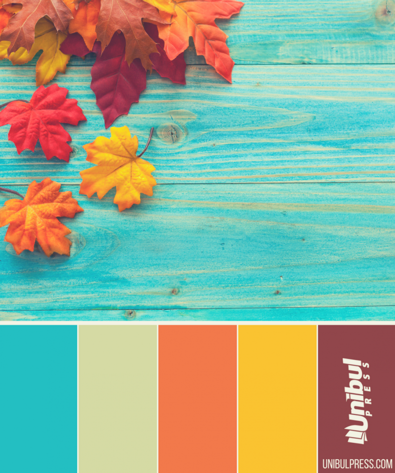 autumn coloring palettes - leaves in autumn on blue table
